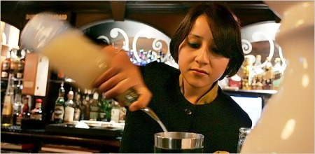In this photo published by The New York Times, a confident Anushika Pradhan is seen tending bar at the Dublin Pub in the Maurya Sheraton Hotel in New Delhi, India.