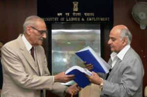 Justice Majithia (left), Chairman of the Wage Boards for working journalists and non-journalists and other newspaper employees, submitting the recommendations to Labour Secretary P.K. Chaturvedi in New Delhi