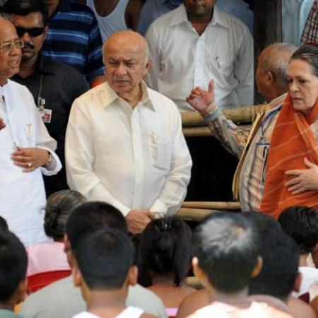 Union Home Minister Sushil Kumar Shinde and National Advisory Council Chairperson Sonia Gandhi along with Assam Chief Minister Tarun Gogoi talking to the riot victims, at Deborgaon Relief camp, in Kokrajhar district of Assam on August 13, 2012.