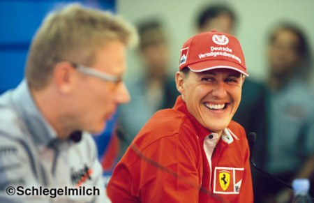 Michael Schumacher and Mika Häkkinen have fun during press conference