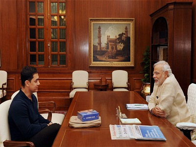 New Delhi : Prime Minister Narendra Modi with actor Aamir Khan at a meeting in New Delhi on Monday. PTI Photo (PTI6_23_2014_000122A)